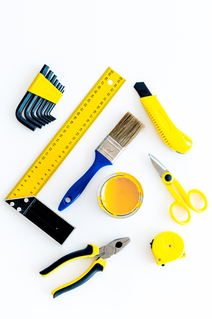 pliers: building, painting and repair tools for house constructor work place set white background top view pattern