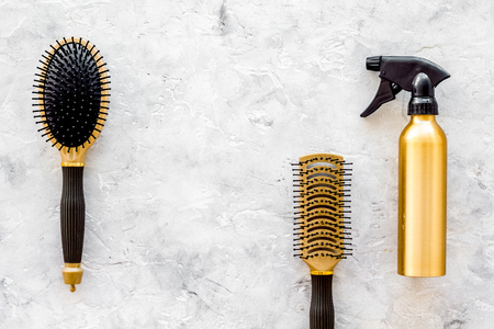 barber: beauty salon golden work tools with comb for hair dress and coloring on stone desk background top view mock up