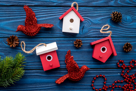 new year 2018 greeting with spruce branches and decorations with house toys on blue wooden background top veiw