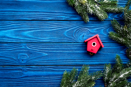 New Year decorations with toys and christmas tree branche on blue wooden background top veiw mock up Stock Photo