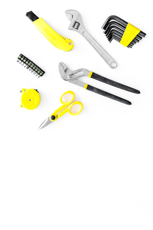 constructor desk with set of building implements on white desk background top view mock up