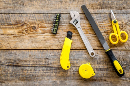 building, painting and repair tools for house constructor work place set on wooden background top view space for text