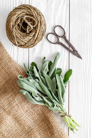 Fresh herbs and greenery for spices and cooking on white wooden kitchen desk background top view Stock fotó - 85536620