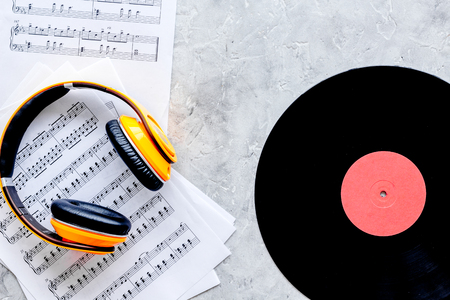Headphone, vynil record with paper note in music studio for dj or musician work on stone desk background top view Stock Photo - 85537946