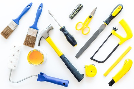 house renovation with implements set for building, painting and repair on white table background top view