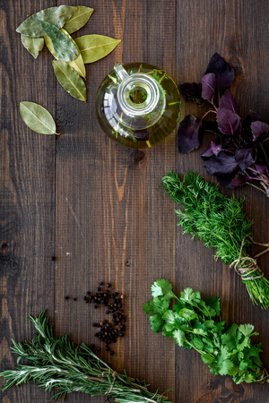 home cooking with fresh greenery and organic oil on wooden kitchen table background top view mock up Фото со стока