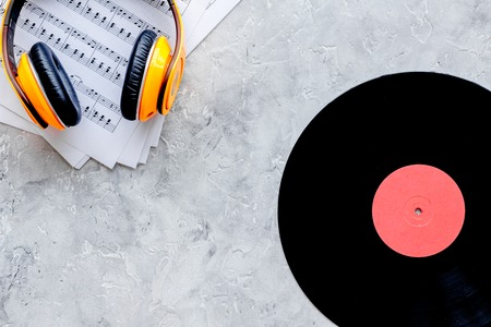 songwriter or dj work place with vynil and headphones on stone desk background top view mockup Stock Photo