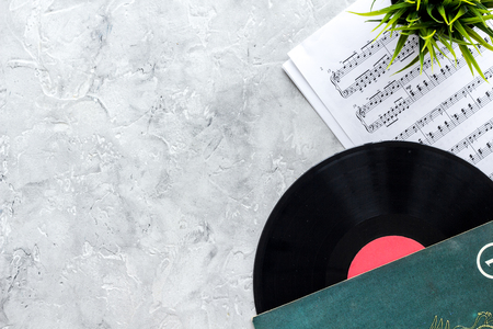 vynil record with paper note in music studio for dj or musician work on stone desk background top view mock-up