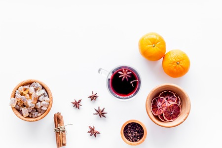 Ingredients of hot mulled wine or grog set with spices and citrus for winter evening. Christmas and new year eve. White background top view. Space for text Stock Photo - 85689529