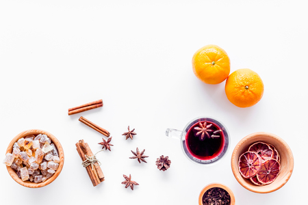 Celebrate new year winter evening with hot drink. Mulled wine or grog ingredients. White desk background top view. Space for text Stock Photo