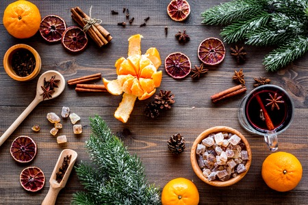 Ingredients of hot mulled wine or grog set with spices and citrus for winter evening. Christmas and new year eve. Wooden background top view. Stock Photo