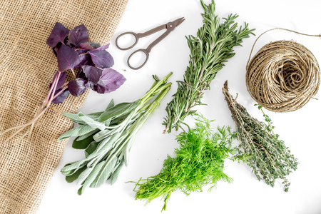 making spices with fresh herbs and greenery for cooking on white kitchen table background top view pattern Stock fotó - 85980214