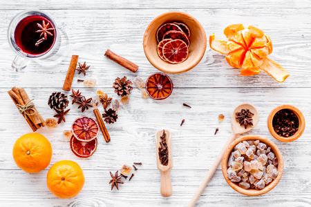 Celebrate new year winter evening with hot drink. Mulled wine or grog ingredients. White desk background top view. Stock Photo - 86079364