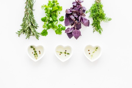 olive green: home cooking with fresh greenery and organic oil on white kitchen table background top view mock up Stock Photo