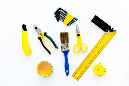 set of tools for build, paint and repair house on white desk background top view