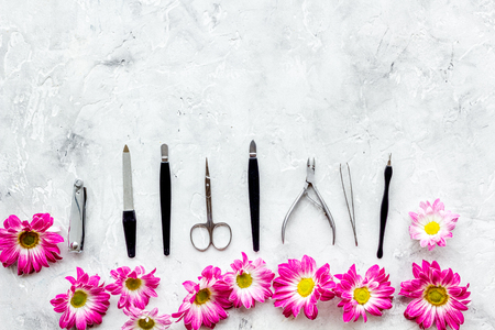Hand care. Set of manicure tools and flowers on white background top view