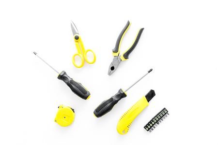 constructor desk with set of building implements on white desk background top view Stock Photo
