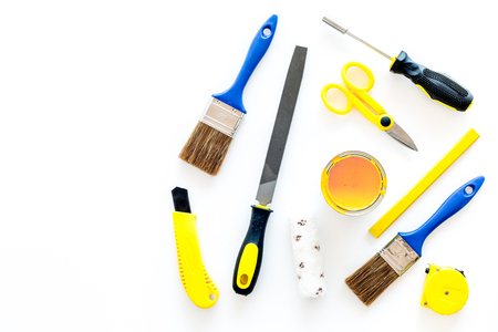 set of tools for build, paint and repair house on white desk background top view mock-up