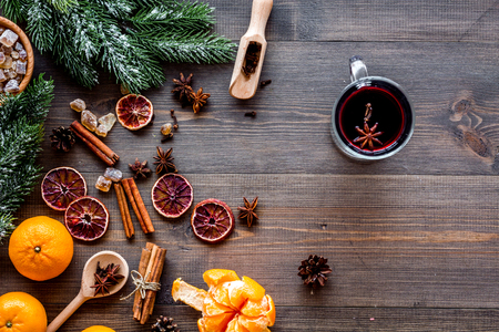 Celebrate new year winter evening with hot drink. Mulled wine or grog ingredients. Wooden desk background top view. Space for text Stock Photo - 86143040