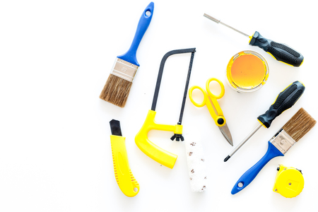 house renovation with implements set for building, painting and repair on white table background top view mockup Stock Photo