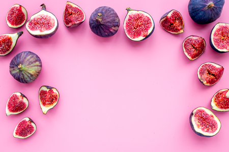 Fresh blue figs slices pattern on pink background top view.