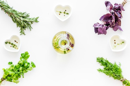greenery with natural oil for home food cooking on white kitchen table background top view Reklamní fotografie