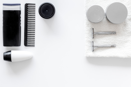 Mens shaving. Tools and cosmetics on white background top view.