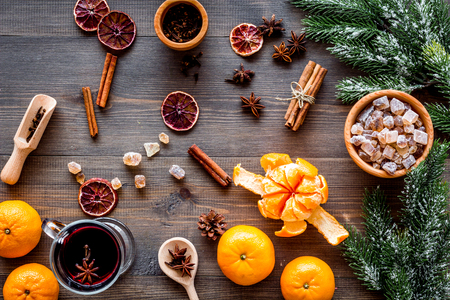 Merry christmas in winter evening with warm drink. Hot mulled wine or grog with fruits and spices on wooden desk background top view Stock Photo - 86298610