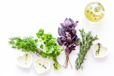 natural oil and fresh greenery for restaurant cooking on white kitchen table background top view space for text