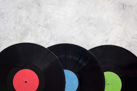 Workplace of DJ. Vinyl records on grey background top view