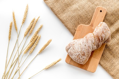 bakery shop set with fresh wheaten bread on table white background top view