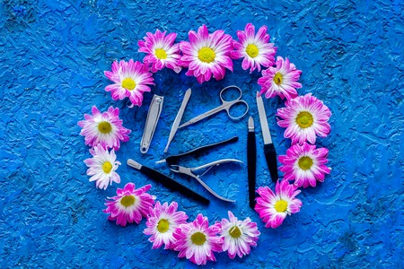 Manicure in beauty salon. Tools for manicure on blue desk top view
