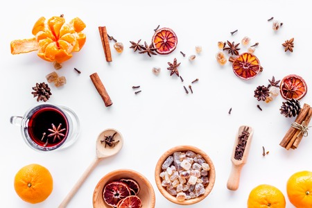 Ingredients of hot mulled wine or grog set with spices and citrus for winter evening. Christmas and new year eve. White background top view. Stock Photo