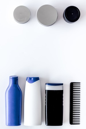 Cosmetics for mens hair on white background top view copyspace