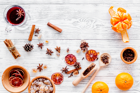 Ingredients mulled wine or grog with spices and citrus for winter evening. Christmas new year eve. Wooden background top view. Stock Photo