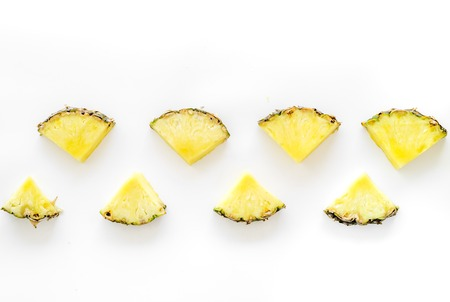 Pinneapple slices pattern on white background top view.