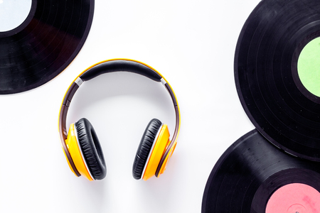 Workplace of DJ. Vinyl records and headphones on white background top view. Reklamní fotografie
