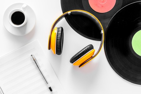 Compositors workplace. Vinyl records, headphones, music notes on white background top view.
