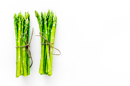 Sprout of fresh asparagus on white background top view.