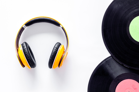 Workplace of DJ. Vinyl records and headphones on white background top view