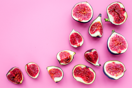 Fresh blue figs slices pattern on pink background top view copyspace