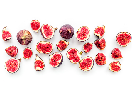 Fresh blue figs slices pattern on white background top view