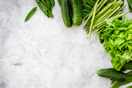 cucumbers: Green healthy snack on grey background top view. Stock Photo