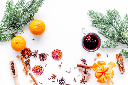 Hot mulled wine or grog cooking for new year celebration with oranges and spices ingredients on white background flat lay Stock Photo - 87351203