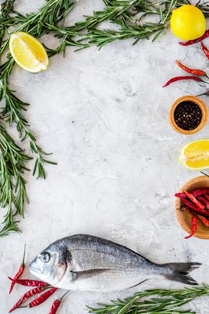 Preparing dorado with spices. Grey background top view.
