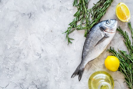 Fresh dorado fish ready to cook on grey background top view. Stock Photo