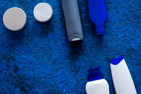 Shampoo and shower gel for men on blue background top view. Stock Photo