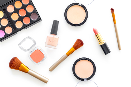 Cosmetics set with beige and nude tones for natural makeup on white background top view. Фото со стока - 87670681
