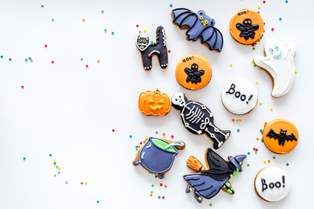 Bright halloween gingerbread cookies on white background top view.