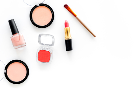 Cosmetics set with beige and nude colors on white background top view. Фото со стока